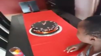 Kansiime Anne cuts the new years cake.mp4