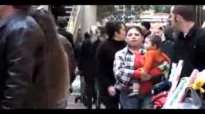 People singing Christmas songs at the mall and everybody sings along wonderful and touching.flv
