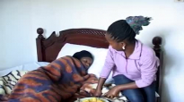 Kansiime Anne attending to a patient.mp4